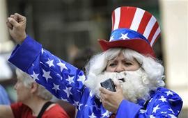 woman at a rally dressed as Uncle Sam