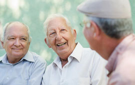 elderly gentlemen engaged in conversation