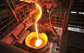 molten steel being poured in a factory